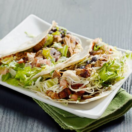 prepared food: two soft shell chicken tacos