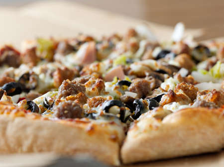 Pizza closeup with supreme toppings photo