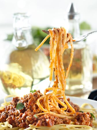 spaghetti hanging on a fork at dinner Stock Photo - 9833765