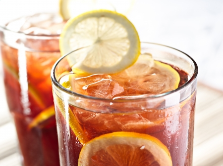 ice water: two glasses of iced tea with lemon garnish closeup
