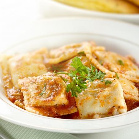 pasta dish: ravioli with garnish closeup Stock Photo