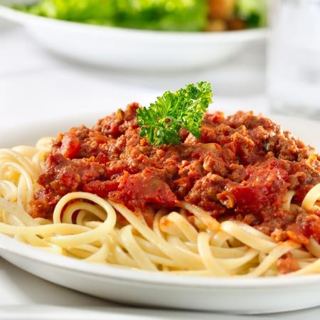 spaghetti pasta with tomato beef sauce closeup