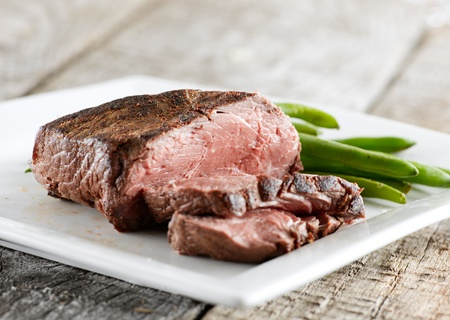 sirloin steak with green beans photo