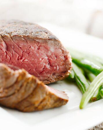 sirloin steak with green beans closeup photo