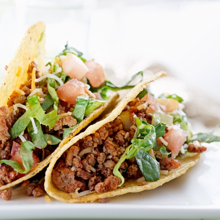tacos: Beef tacos with lettuce cheese and tomato Stock Photo