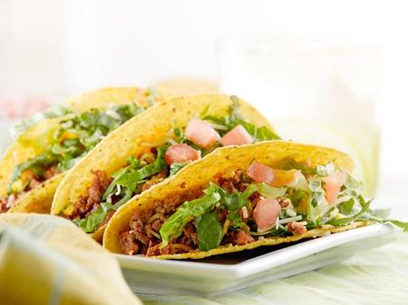 tacos: a platter of three tacos Stock Photo