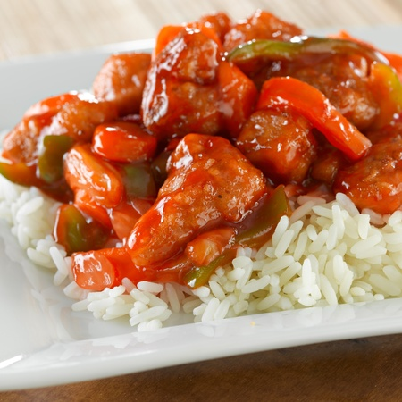sweet and sour pork on rice photo