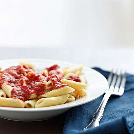 penne pasta in tomato sauce with copyspace Stock Photo - 12925163