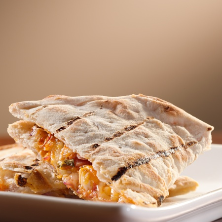 plate of chicken and cheese quesadillas with copyspace  photo