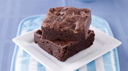 brownie: two brownies stacked on a plate