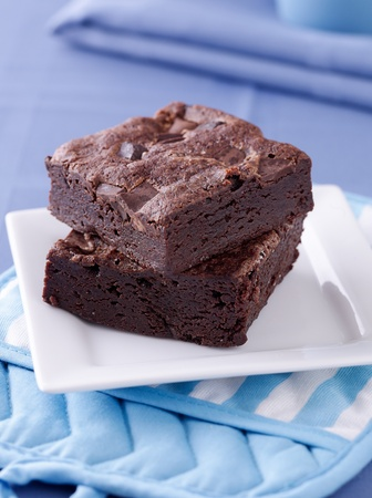 chocolate brownie: two brownies stacked on a plate
