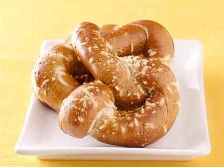 pretzels: two pretzels on a plate Stock Photo