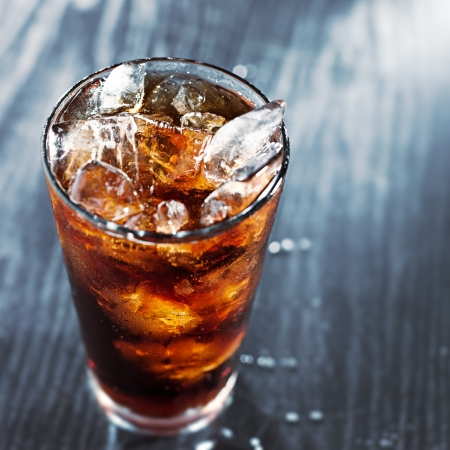 cola: glass of cola with ice with copyspace in composition
