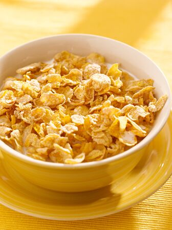 bowl of crunchy corn flakes for breakfast photo