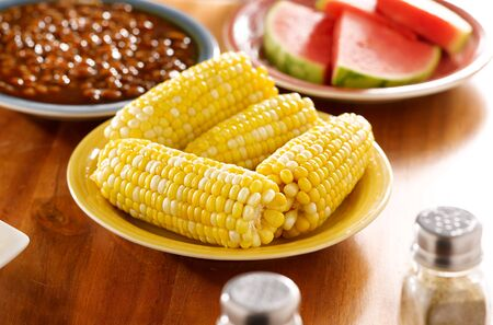 meal with corn on the cob on a plate photo