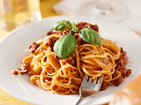 spaghetti with basil garnish in meat sauce Stock Photo