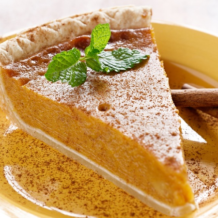 pumpkin pie with mint garnish. photo