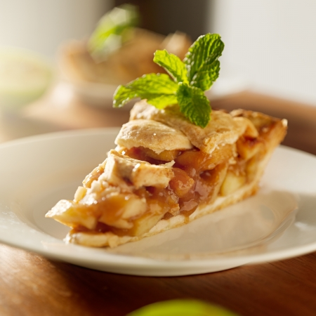 apple pie with mint garnish.