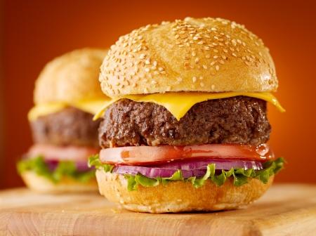 cheeseburgers on wooden board. photo