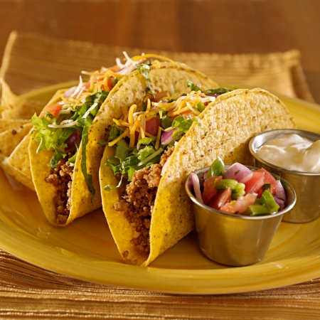 Tacos on a platter with tortillas - mexican food photo