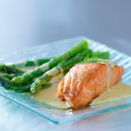 entrees: Salmon fillet with asparagus and yellow sauce