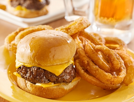 mini burgers with cheese and onion rings served with beer  photo