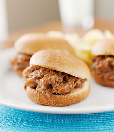 take out food: three pulled pork bbq mini sandwhich sliders