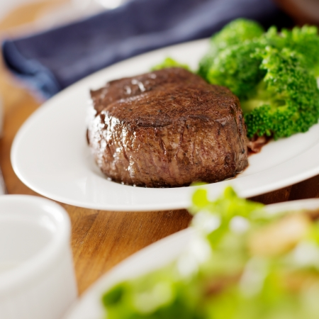 steak dinner with salad and broccoli  photo