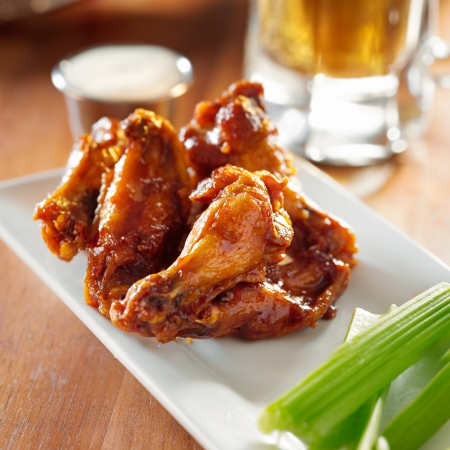 bbq buffalo wings with celery and ranch. photo