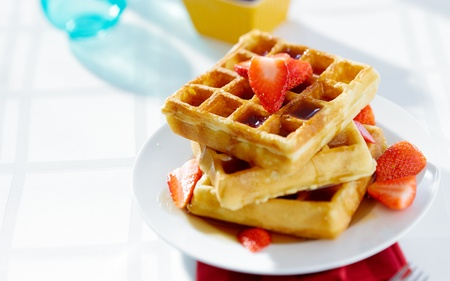 breakfast food: waffles for breakfast with strawberries, shot with copyspace composition