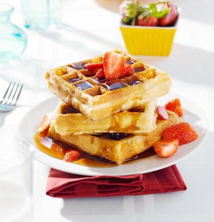 belgian: breakfast - waffles with syrup and strawberries Stock Photo
