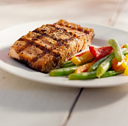entree: grilled salmon with vegetables Stock Photo