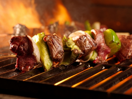 beef shish kababs on the grill Stock Photo
