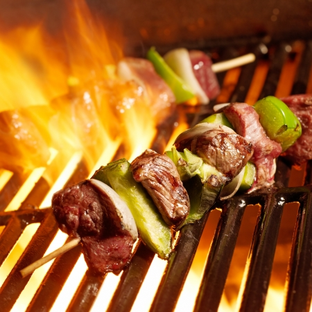 beef shish kabobs on the grill photo