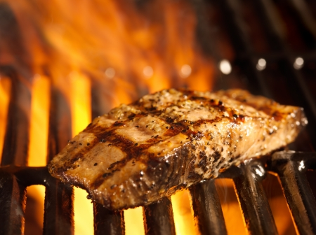grill: salmon fillet on the grill with flames