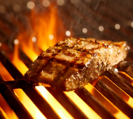 grilled fish: salmon fillet on the grill with flames