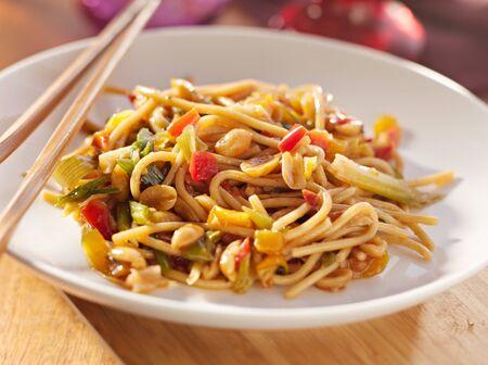 stir fried: spicy thai noodles with chopsticks