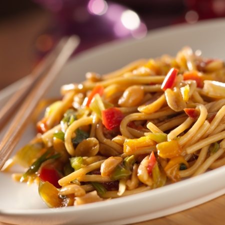 close up food: spicy thai noodles with chopsticks
