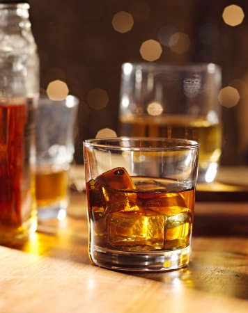 whiskey glass: cocktail glass of whiskey on wood bar Stock Photo