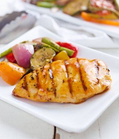 barbecued chicken with fresh vegetable sides photo