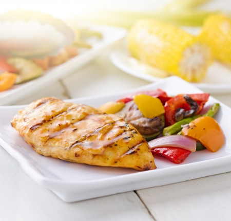 bbq chicken: summertime barbecue chicken with vegetables.