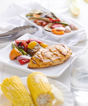staycation: summertime bbq grilled chicken and vegetables with corn on the cob.