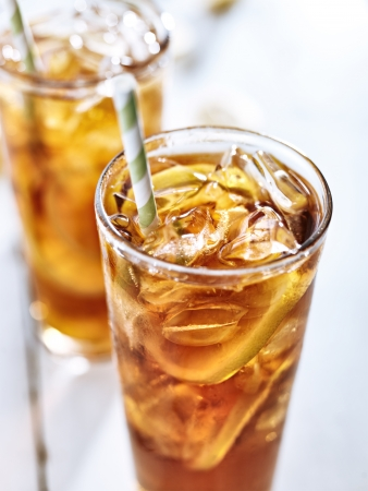ice cold: ice tea with straw closeup