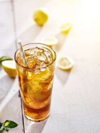 red tea: cold iced tea with lemons and copy space composition