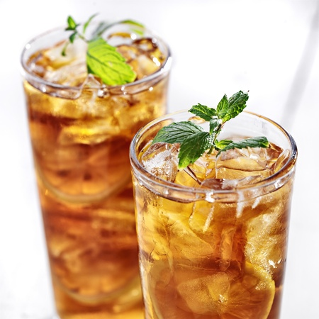 iced tea: cold iced tea with mint garnish and sliced lemons Stock Photo