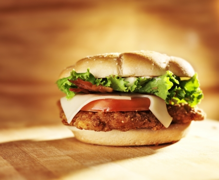 crispy chicken sandwich with bacon and swiss cheese.