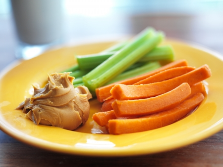 kids food - peanut butter with celery and carrots. Reklamní fotografie