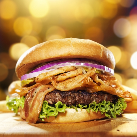 gourmet bacon hamburger with golden background and copy space composition. photo
