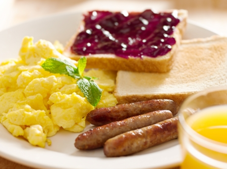 link up: breakfast food - american style breakfast with scrambled eggs, sausage and toast.