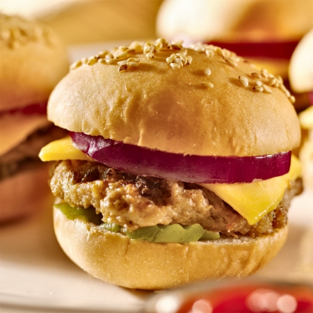 american cuisine: mini burgers with cheese, onion and pickle  Stock Photo